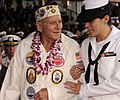 US Navy 091207-N-7498L-470 Personnel Specialist 3rd Class Kathleen McDowell escorts Pearl Harbor attack survivor Woody Derby during a U.S. Navy and National Park Service ceremony.jpg