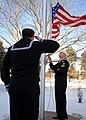 US Navy 091223-N-9898L-006 Aviation Electronics Technician 2nd Class Alejandro Benavides renders honors as Aviation Structural Mechanic 1st Class Andrew Johnson lowers the American flag outside of the Navy Operational Support C.jpg