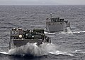 US Navy 100125-N-9950J-029 Two landing craft utility vehicles assigned to Assault Craft Unit (ACU) 1 approach the well deck of the forward-deployed amphibious assault ship USS Essex (LHD 2).jpg