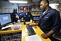 US Navy 100130-N-1688B-129 Storekeeper Seaman William Selmon helps customers with purchases in the ship's store aboard the guided-missile cruiser USS Hue City (CG 66).jpg