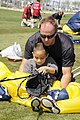 US Navy 100327-N-5366K-135 James Woods lets a child help deflate his parachute.jpg