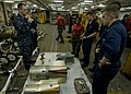 US Navy 100717-N-0754Y-013 Aviation Ordnanceman 1st Class Sam Money instructs Sailors in identifying the components of an MK 62-63 Quickstrike training mine.jpg