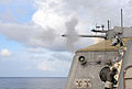 US Navy 100721-N-7058E-835 The littoral combat ship USS Freedom (LCS 1) fires one of its Mk-46 30mm chain guns during a live-fire exercise off the coast of Kauai, Hawaii.jpg