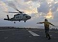 US Navy 101209-N-9950J-049 Aviation Boatswain's Mate (Handling) 3rd Class Eldeen Ebanks directs a Japan Maritime Self Defense Force SH-60K Sea Hawk.jpg