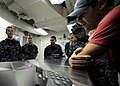 US Navy 101224-N-8824M-092 Sailors aboard the aircraft carrier USS Abraham Lincoln (CVN 72) gather around a telephone speaker for a holiday phone c.jpg