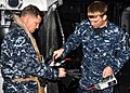 US Navy 110329-N-OM503-037 Machinist's Mate 1st Class Nicholas Gerloff uses a Radiac meter on Rear Adm. Jeffery.jpg