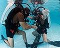 US Navy 110524-N-OT964-419 Lt. Dan Bailey, left, assigned to Commander Task Group (CTG) 56.1, conducts underwater checks on Lt. Chris Kent, deputy.jpg
