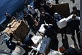 US Navy 111210-N-NP071-036 Sailors move supplies during a replenishment at sea.jpg