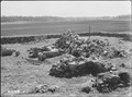 View toward Duke of Cumberland Bastion with partially restored fireplaces in center and in foreground. The land in... - NARA - 280292.tif