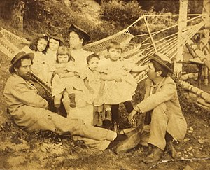 Barbu Ștefănescu Delavrancea - Photograph of Romanian writers Alexandru Vlahuță (right) and Barbu Ștefănescu Delavrancea (left), with Barbu's daughters, future pianist Cella Delavrancea and architect Henrieta Delavrancea-Gibory