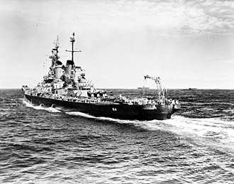 USS Wisconsin (BB-64) - Wisconsin escorting US Essex-class aircraft carriers in the Pacific Ocean during World War II. The tail crane was used to recover reconnaissance planes launched by Wisconsin.