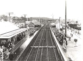 Wyong railway station - Wyong station in 1954. The crowd is awaiting the arrival of Queen Elizabeth II.