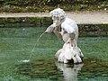 Wasserspiele Hellbrunn wasserspeiende Statue.jpg