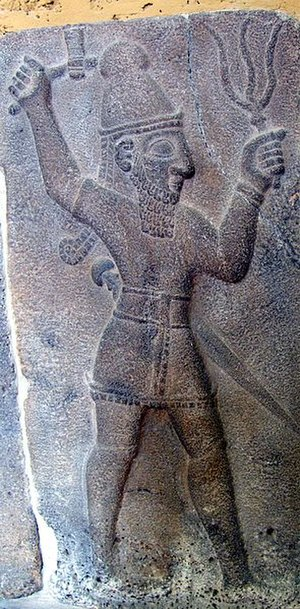 Teshub - The Hittite weather-god wielding a thunderbolt and an axe. Bas-relief at Ivriz