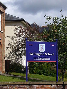 Wellington School Front Gates Logo.JPG