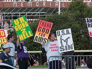 The Most Hated Family in America - Westboro Baptist Church members with protest signs (2005)