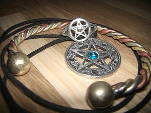 Magical tools in Wicca - A selection of jewellery used in Wiccan ritual. Most depict the pentagram.