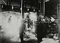 Women loading nitrate of soda into a skip (15273634830).jpg