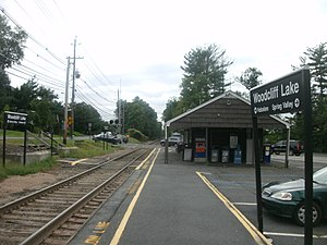 Woodcliff Lake station - The Woodcliff Lake station facing southbound along the tracks. Bergen County Route 90 is visible in the background. The old Erie Railroad station is visible on the right side.