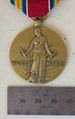 World War II Victory Medal - Obverse with ruler.png