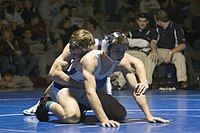 Usually at the start of the second and third periods, both wrestlers start in the referee's position, with one wrestler on the bottom with hands spread out and feet held together, and one wrestler on the top with his hand around the opponent's waist for control.