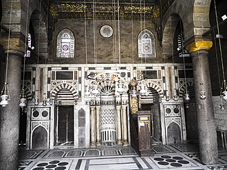 Mosque-Madrassa of Sultan Barquq - Qibla wall with mihrab in the middle, crowned with four pillars.