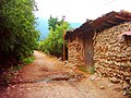 خانه کاه گلی و جاده خاکی - panoramio.jpg