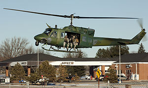 90th Operations Group - 90th Wing security forces prepare to jump out of a 37th Squadron UH-1N at Warren AFB