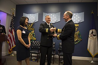 Vice Admiral James Bond Stockdale Award for Inspirational Leadership - Image: 121127 N WL435 068 Chief of Naval Operations (CNO) Adm. Jonathan Greenert presents the Vice Adm. James Bond Stockdale Leadership Award to Cmdr. Chase Patrick