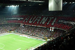 The San Siro stadium، filled to capacity، during a match between AC Milan and Inter Milan.
