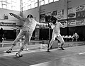 2nd Leonidas Pirgos Fencing Tournament. The fencer on the left extends his arm and scores a touch.jpg