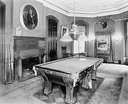 Billiard room with pool table, fireplace, and a hunting trophy