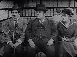 Frank Alexander (actor) - Syd Chaplin, Frank Alexander, and Joy Lewis in A Lover's Lost Control (1915)