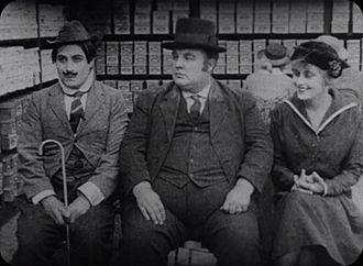 Frank Alexander (actor) - Syd Chaplin, Frank Alexander, and Joy Lewis in A Lover's Lost Control (1915)