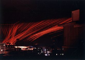 Pylon turn - Tracer from an AC-47D converging at the center area of a pylon turn over Saigon, 1968