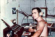 Armed Forces Vietnam Network disc jockey SP4 Tim Abney broadcasts for The Big Red One at radio KLIK in Lai Khe, 1967