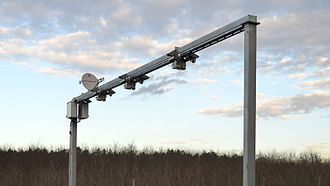 Intelligent transportation system - Traffic monitoring gantry with wireless communication dish antenna