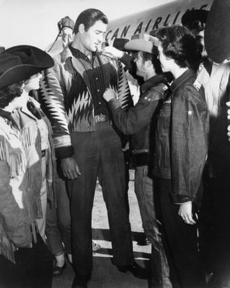 Clint Walker - Walker being pinned with a Sheriff's Badge at Frontier Fiesta at the University of Houston (circa 1950s)