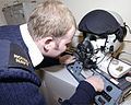 A Fleet Air Arm Survival Equipment Specialist run checks on a flying helmet at 1 Squadron , RAF Cottesmore MOD 45147880.jpg