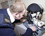 A Fleet Air Arm Survival Equipment Specialist run checks on a flying helmet at 1 Squadron , RAF Cottesmore MOD 45147880.jpg