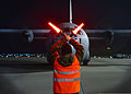 A Polish airman marshals a U.S. Air Force C-130J Super Hercules aircraft March 13, 2014, at Lask Air Base, Poland 140313-F-BH566-088.jpg