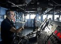 A Sailor steers USS Tortuga. (8455082729).jpg
