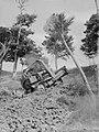 A man in a bulldozer ascending a hill (AM 77375-1).jpg