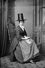 A woman in national dress knitting (Jones)
