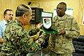 Afghan National Army Maj. Gen. Mohammed Zaman Waziri, front left, the commander of the 201st Corps, presents the crest of the 201st Corps to U.S. Army Gen. Lloyd Austin III, the commander of U.S. Central 131006-A-CB167-004.jpg
