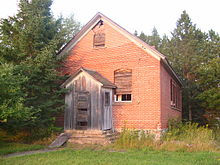 Photograph of a one room schoolhouse in northern Price County, Wisconsin.