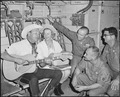 Air Borne Sing-A-Long. Roy and Dale Rogers entertain crew members of an Air Force C-123 Provider during the last leg... - NARA - 542298.tif
