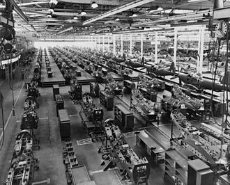 Mass production - The assembly plant of the Bell Aircraft Corporation in 1944. Note parts of overhead crane at both sides of photo near top.