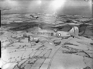RAF Carew Cheriton - Avro Anson Mk.I K6285/MW-F foreground and Avro Anson Mk.I N9742/MW-Y background of No.321 (Dutch) Squadron RAF.