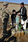 Airmen and Afghan well mission 130126-F-LR266-415.jpg